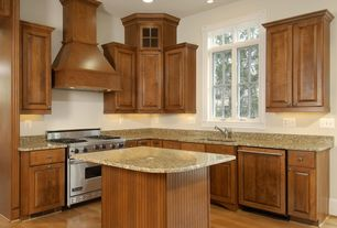 Traditional Kitchen with Simple granite counters, Kitchen island, Undermount sink, Simple Granite, Raised panel, Glass panel