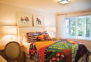 Traditional Guest Bedroom with Wainscotting, Laminate floors, Crown molding, flush light