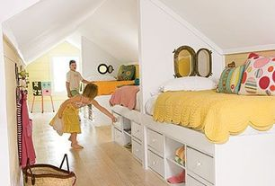 Contemporary Kids Bedroom with Skylight, Built-in bookshelf, Hardwood floors