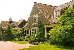 Traditional Exterior of Home with Columns, Wood shingle siding, Brick pathway