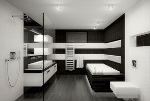 Contemporary Master Bathroom with Inset cabinets, flush light, Laminate floors, Bathtub, Standard height, drop in bathtub