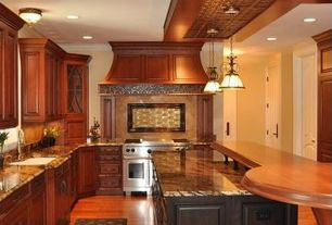 Traditional Kitchen with Raised panel, Complex granite counters, Stone Tile, One-wall, Custom hood, double oven range