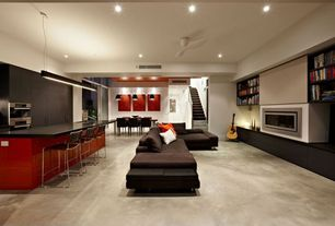 Contemporary Great Room with Standard height, Built-in bookshelf, Fireplace, Pendant light, Carpet, sliding glass door