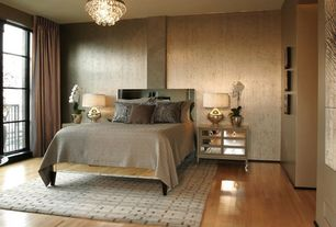 Contemporary Master Bedroom with Laminate floors, Chandelier, Glass panel door, interior wallpaper