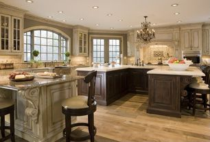 Traditional Kitchen with Upholstered bar stool, U-shaped, Breakfast bar, French doors, Kitchen island, Half arch window
