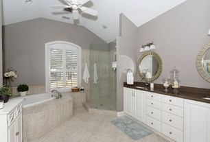 Contemporary Master Bathroom with Raised panel, frameless showerdoor, wall-mounted above mirror bathroom light, Ceiling fan