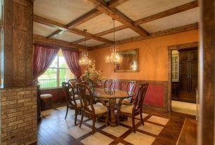 Craftsman Dining Room with interior brick, Exposed beam, Chandelier, Hardwood floors, Box ceiling, Wainscotting