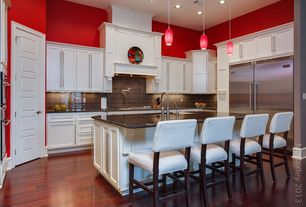 Contemporary Kitchen with can lights, Built In Refrigerator, Custom hood, full backsplash, Flat panel cabinets, High ceiling