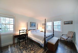 Traditional Guest Bedroom with Laminate floors, Art desk, Crown molding, High ceiling