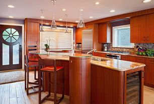 Modern Kitchen with Stone Tile, Glass panel door, Glass counters, Undermount sink, Complex granite counters, Kitchen island