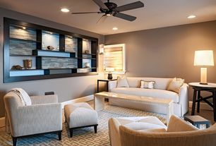 Contemporary Living Room with Built-in bookshelf, Ceiling fan, Wall sconce, Laminate floors