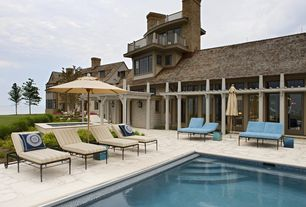 Cottage Swimming Pool with exterior stone floors, Pathway, Trellis, Transom window, French doors