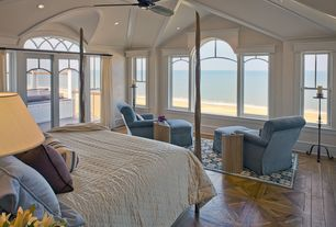 Traditional Master Bedroom with Parquet wood floor, Hardwood floors, Arched window, Ceiling fan