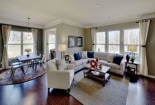 Traditional Great Room with Standard height, Crown molding, Pendant light, double-hung window, Hardwood floors
