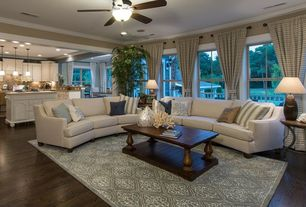 Traditional Living Room with Hardwood floors, Ceiling fan, Crown molding