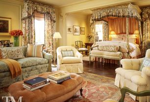 Traditional Master Bedroom with specialty window, Columns, Hardwood floors, Crown molding, bedroom reading light, can lights