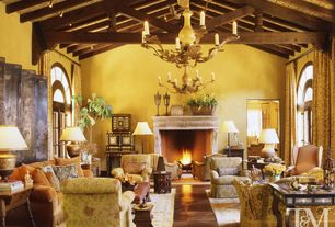Traditional Great Room with Exposed beam, can lights, brick fireplace, Arched window, Laminate floors, French doors, Paint