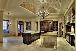 Mediterranean Kitchen with French doors, Built-in bookshelf, Chandelier, travertine tile floors, Transom window