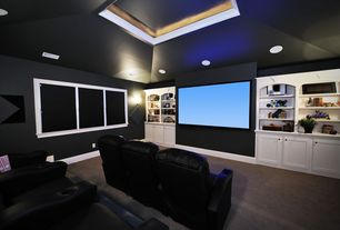 Modern Home Theater with Carpet, Built-in bookshelf, Home theater seating, Wall sconce