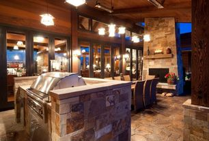 Country Patio with Outdoor fireplace, Outdoor kitchen, exterior stone floors, Covered patio, French doors