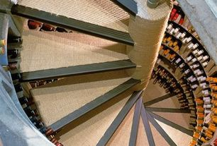 Contemporary Wine Cellar with Custom wine storage, Carpet, Spiral staircase, Wooden Octagonal Wine Rack - 12 or 40 Bottles