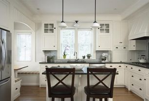 Traditional Kitchen with Bronze cup pull, Kitchenaid stand mixer, Kitchen island with seating, Soapstone counters