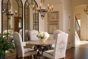 Traditional Dining Room with Distiller arch mirror, Hardwood floors, High ceiling, Crown molding, Chandelier