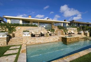 Modern Swimming Pool with Raised beds, Fountain, French doors, exterior stone floors