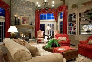 Traditional Living Room with Fireplace, stone fireplace, French doors, Transom window, Chandelier, Laminate floors