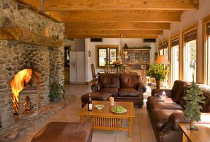 Rustic Living Room with Chandelier, Standard height, Exposed beam, picture window, Concrete tile , Fireplace, stone fireplace