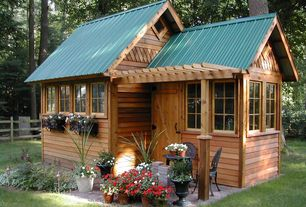 Craftsman Garage with Corrugated metal roof, Wrought iron patio furniture, specialty door, Cedar siding, Garden shed, Arbor