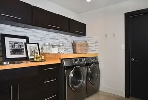 Contemporary Laundry Room with Built-in bookshelf, Concrete floors, Dura supreme lift up storage, limestone floors