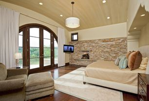 Contemporary Master Bedroom with picture window, insert fireplace, flush light, Fireplace, Hardwood floors, French doors