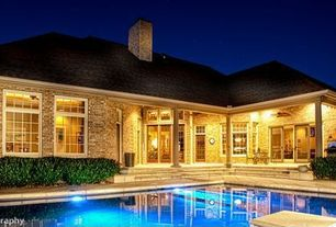 Traditional Swimming Pool with Outdoor kitchen, exterior concrete tile floors, picture window, French doors, Transom window