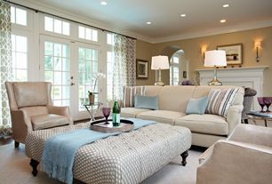 Contemporary Living Room with Standard height, can lights, Crown molding, Carpet, Transom window, French doors