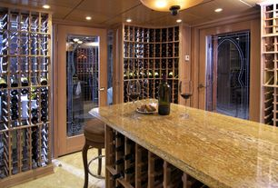 Modern Wine Cellar with travertine floors, Glass panel door, flush light, can lights, Standard height
