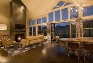 Contemporary Great Room with Laminate floors, Chandelier, picture window, stone fireplace, Balcony, can lights, Fireplace