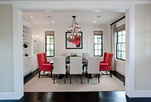 Contemporary Dining Room with Dark hardwood floors, Roman shades, Hardwood floors, Wall sconce, Crown molding, Chandelier