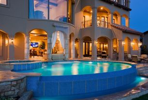 Mediterranean Swimming Pool with French doors, Pool with hot tub, exterior stone floors, picture window, Deck Railing