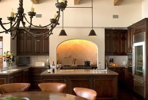 Mediterranean Kitchen with Raised panel, High ceiling, Wrought iron chandelier, Undermount sink, Dupont Dove Corian