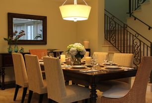 Modern Dining Room with Travertino beige glazed porcelain floor and wall tile, Paint, Metal railing
