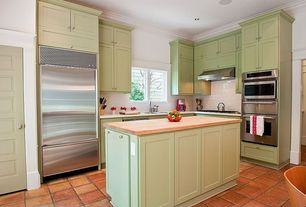 Traditional Kitchen with L-shaped, Advanta Cabinets - Rutledge 5pc in Sage Finish, Corian counters, terracotta tile floors