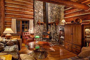 Rustic Living Room with High ceiling, Hardwood floors, Exposed beam, Built-in bookshelf