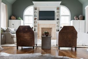 Contemporary Living Room with CB2 Cement Grey Side Table, Arched window, Hardwood floors, Built-in bookshelf