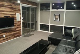 Modern Home Theater with Wood paneling walls, Rectangular coffee table with glass top and lower shelf