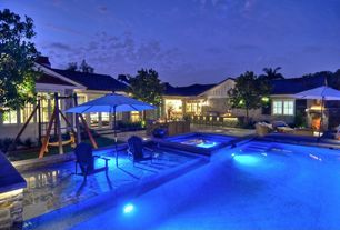 Traditional Swimming Pool with In pool seating, Outdoor fireplace, Outdoor bar, Pool with hot tub, Swing set