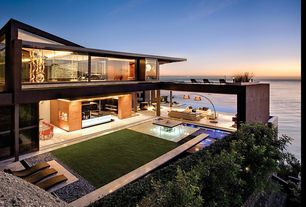 Contemporary Exterior of Home with Ocean view, Curtain wall, Outdoor furniture
