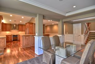 Contemporary Dining Room with Hardwood floors, Crown molding, Wainscotting, Columns, Ethan Allen Mitchell Dining Chair