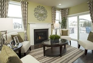 Traditional Living Room with Deco Accent Chair, specialty door, double-hung window, Fireplace, Standard height, can lights