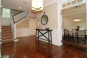 Contemporary Entryway with Crown molding, Chair rail, picture window, Transom window, flat door, flush light, Hardwood floors
